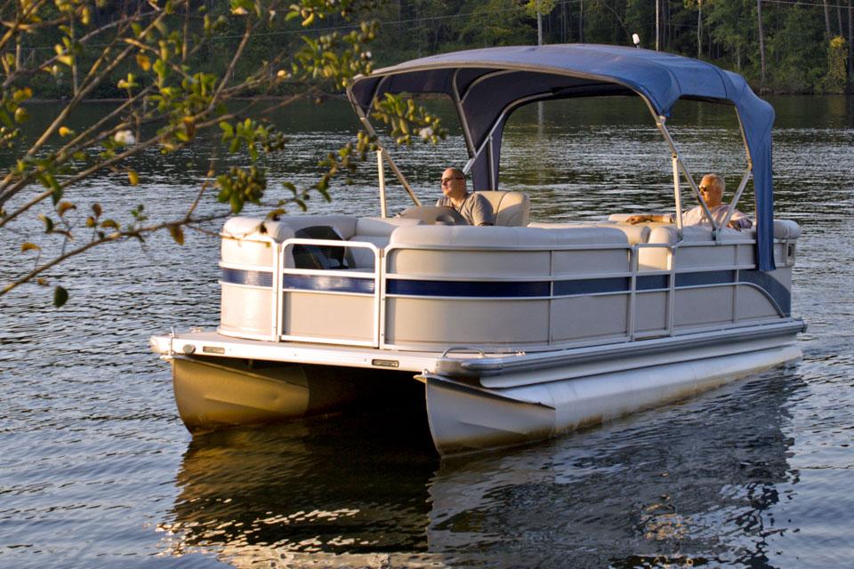 two-men-driving-pontoon-boat-on-lake
