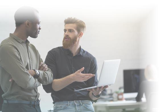 two men talking with laptop